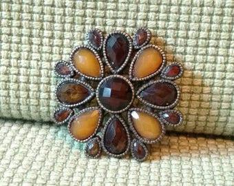 Brown brooch