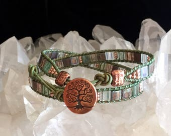 Flat wrap, green leather, shades of green Miyuki Tila beads, copper seed beads, copper Tree of Life button