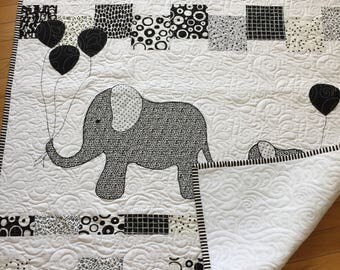 Handmade black and white appliqued elephant baby quilt. Baby quilt with white minky backing. Ready to ship. Canadian made