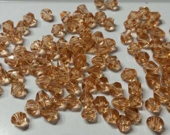 20 perles à facettes verre toupie 6mm rose saumon