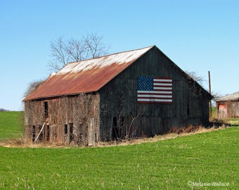 Old Barn With An American Flag On It