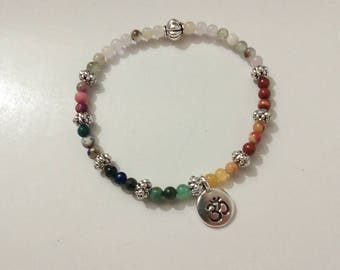 Seven Chakras Bracelet with semi precious stones. Silver plated charms and accents.