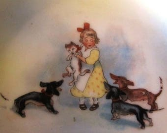 Fine china plates with children and dogs, Germany 1920s