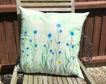Blue field flowers cushion