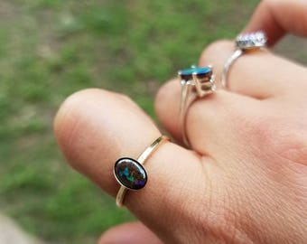 Galaxy boulder opal set in a 14k gold filled setting. Size 5