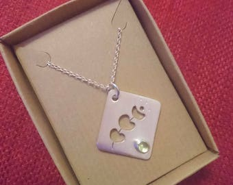 Sterling Ecosilver hand cut pendant with peridot stone, 18inch sterling silver chain.