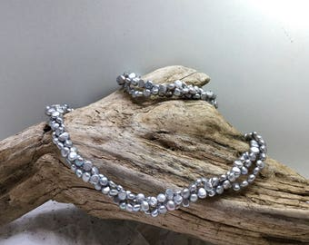 Three string silvery grey fresh-water pearl Necklace and Bracelet
