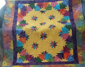 Hunter Star quilt for full size bed made with brightly colored batiks