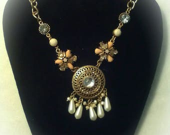 This is a one of a kind necklace with beautiful charm