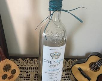 Stella wine bottle with blue LED wine bottle. Stella is a favorite wine of wine lovers.
