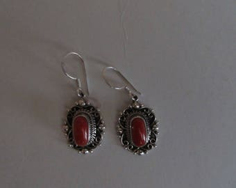 silver earring with coral