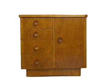 Small solid wood dresser with four drawers in the 1950s
