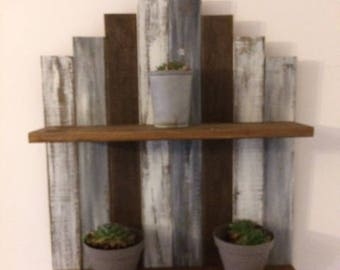 Weathered wood shelf has two Brown shelves