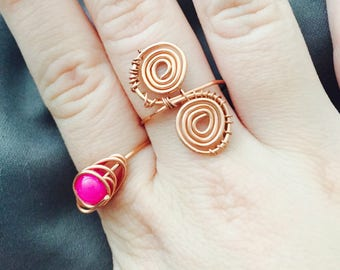 Two Copper Rings, one with a pink bead, the other wire wrapped.