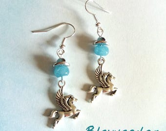Pegasus earrings and blue beads