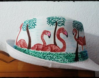 Summer hat with flamingoes and palm trees.