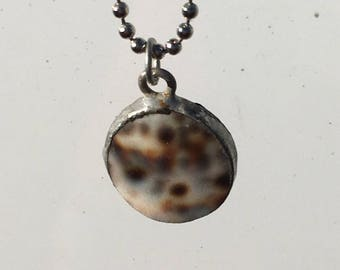 Spotted brown shell hand soldered pendant