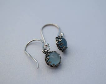 Elegant baby blue Chalcedony drop earrings, set with solid 925 sterling silver on traditional shepherd hooks.