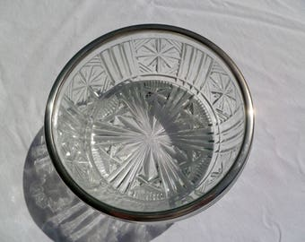 vintage cut glass bowl with silver rim, made in england