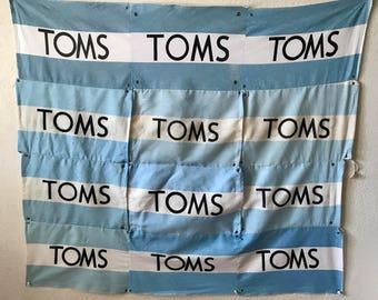 TOMS Flag Banner