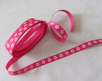 Pink Ribbon backed with small flowers for embellishments