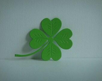 Cut paper design for creating light green clover