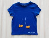 Blue t-shirt, t-shirt with fish, t-shirt with crochet application. For kids. Orange minnow. Painted t-shirt. Made in Italy