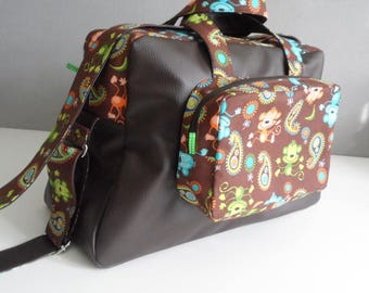Beautiful, large diaper bag or fabric and faux leather travel bag.