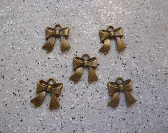 5 charm bow bronze 14 x 15 mm approx