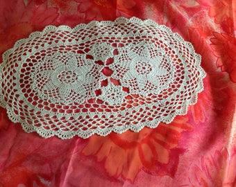 Small vintage oval type bobbin lace doily