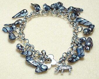 """Barbados"" Silver curb chain bracelet and oblong and Zebra keshis pearls."