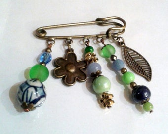 Bohemian brooch or jewelry bag, blue, bronze and green