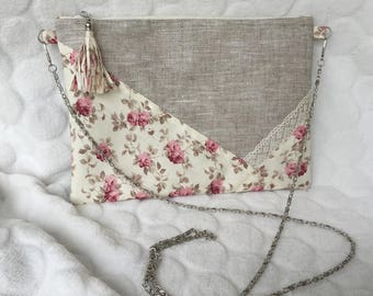 Floral clutch, laminated cotton linen fabric.