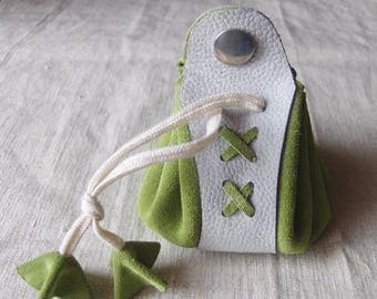 Coin purse is grey-green leather