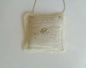 Door in linen and old lace cushion