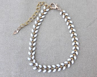 White enamel spike chain bracelet