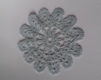 sky blue colored crocheted doily