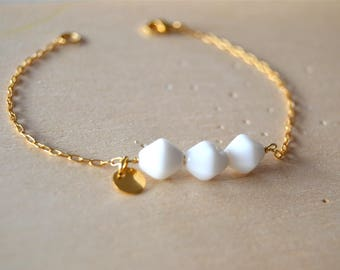 Gold plated bracelet white pearls