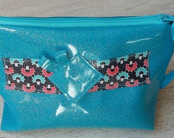 Zip pouch in faux glitter and cotton coated plastic