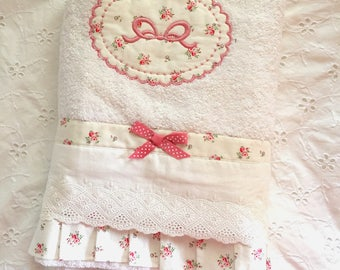 Towel embroidered on fabric floral medallion