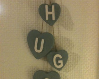 Backed with heart name Garland.