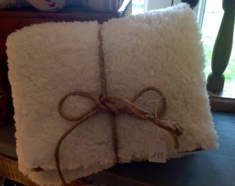 Ecru fur and natural linen clutch
