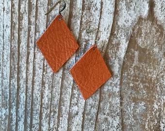 Genuine leather earrings in toasted orange geometric shape