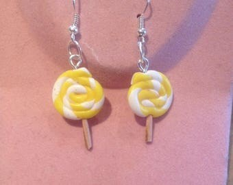 Pierced dangle lollipop shaped earrings