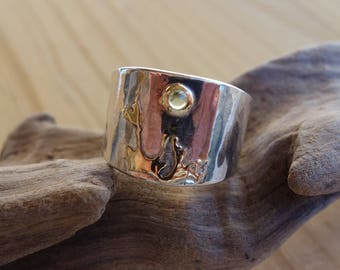 Ring in silver and gold and peridot