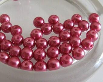 1 lot of 30 6 mm round dark pink glass pearls