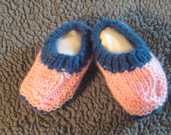Hand knitted baby booties - salmon with dark blue trim