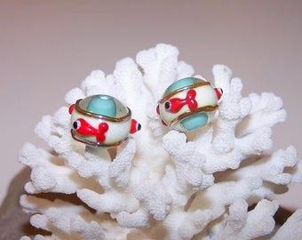 """Duo """"mini goldfish"""" white turquoise background."""