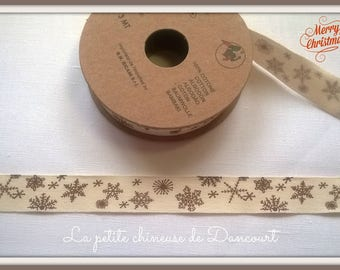 Spool of 3 m tape Brown snowflakes on an ecru background