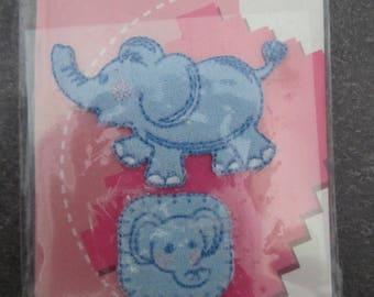 Set of two iron Crea Pecam representing a blue elephant